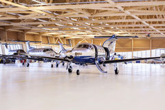 Single turboprop aircraft Pilatus PC-12 in hangar. Stans, Switzerland, 29th November 2010. Royalty Free Stock Photos