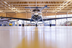Single turboprop aircraft Pilatus PC-12 in hangar. Stans, Switzerland, 29th November 2010. Royalty Free Stock Image