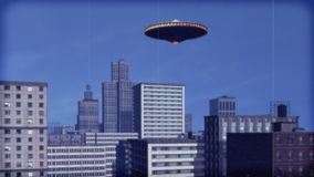 Single UFO over downtown (Color). UFO over downtown. Vintage animation stock footage