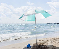 Single umbrella on the beach Royalty Free Stock Image