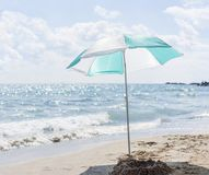 Single umbrella in the sand on the beach Royalty Free Stock Image