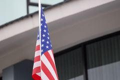 Single United states of ameriaca flag with office building backg Royalty Free Stock Photo