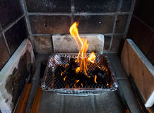 Single use barbecue. With flaming coals Stock Photography