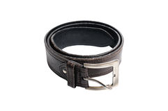 Single used black leather belt on white background. Stock Images