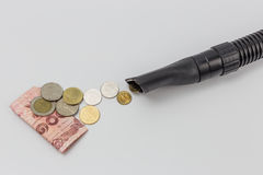 Single vacuum cleaner nozzle sucking thailand money royalty free stock photos