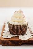 Single vanilla cupcake Royalty Free Stock Photos