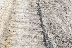 Single Vertical Bull Dozer Track on Road Construction. This Photo represents going the way, the extra mile. A single track from a bull dozer walking its way to royalty free stock photo