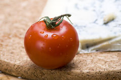 Single vine tomato Stock Photography