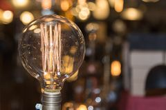 Single Vintage Electric Light Bulb with Incandescent Filament Royalty Free Stock Photos