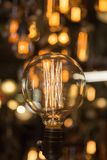 Single Vintage Electric Light Bulb with Incandescent Filament.  Stock Photography