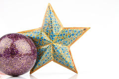 Single violet ball and blue star Royalty Free Stock Photos