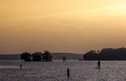Single wake boarder lake at sunset Royalty Free Stock Image