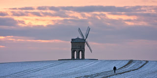 Single walker at Chesterton windmill in winter Stock Photography