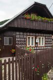 Single wall with decorations in Cicmany village. Cicmany, Slovakia - august 02, 2015: Old wooden houses in Slovakia village Cicmany, traditional painted with Royalty Free Stock Images