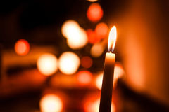 Single wax warm candle light on christmas night with dark background. Single candle light during christmas night Stock Photos