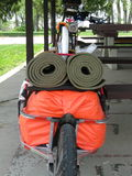 Single wheel bike trailer with bed roles Stock Photo