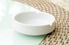 Single white ashtray Stock Photo