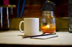 Blank white coffee mug writing under candle light royalty free stock images
