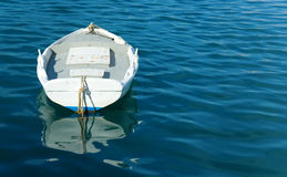 Single white boat and blue sea Stock Image