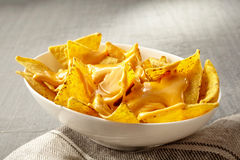 Single white bowl of chips with melted cheese Royalty Free Stock Photos