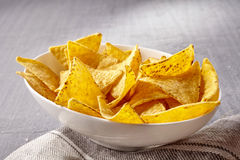 Single white bowl of yellow tortilla chips Royalty Free Stock Photography
