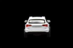 Single white car. On black background Royalty Free Stock Photos