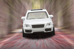 Single white car. On the road blurred Stock Photos