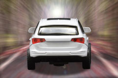 Single white car. On the road blurred Royalty Free Stock Photo