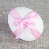 Single White Easter Egg with Pink Ribbon Royalty Free Stock Images