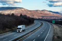 Single White lorry truck on country highway royalty free stock photography
