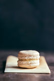 Single white macaroon Stock Images