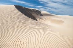 Single white sand dune Stock Images