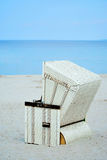 Single wicker beach chair Royalty Free Stock Image