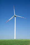 Single wind turbine. Cloudless sky in background Stock Image