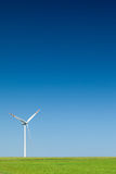 Single wind turbine. Cloudless sky in background Stock Photo