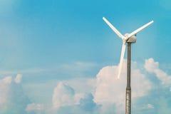 Single wind turbine on the blue sky background Stock Images