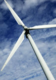 SINGLE WIND TURBINE WITH BLUE SKY. AND CLOUDS Royalty Free Stock Image
