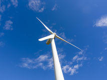 Single wind turbine in blue sky Royalty Free Stock Photo