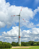 Single wind turbine in the field in rural area in Bavaria Stock Photo