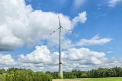 Single wind turbine in the field in rural area in Bavaria Royalty Free Stock Image