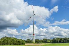 Single wind turbine in the field in rural area in Bavaria Stock Image