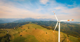 Single wind turbine. Single wind turbine on the green hill Royalty Free Stock Images