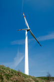 Single wind turbine. On the hill produces green clean energy Stock Image