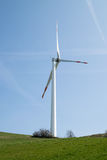 Single wind turbine. On the hill produces green clean energy Stock Photography