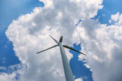 Single wind turbine. Low angle against blue sky with clouds Stock Photos