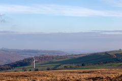 Single wind turbine in open english landscape royalty free stock photography