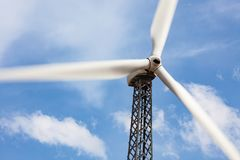 Single Wind Turbine Over Dramatic Blue Sky Royalty Free Stock Photo