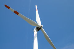 Single wind turbine. Produces green clean energy Royalty Free Stock Photos