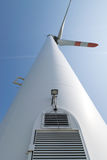 Single wind turbine. Produces green clean energy Stock Photo