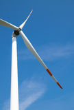 Single wind turbine. Produces green clean energy Royalty Free Stock Photo